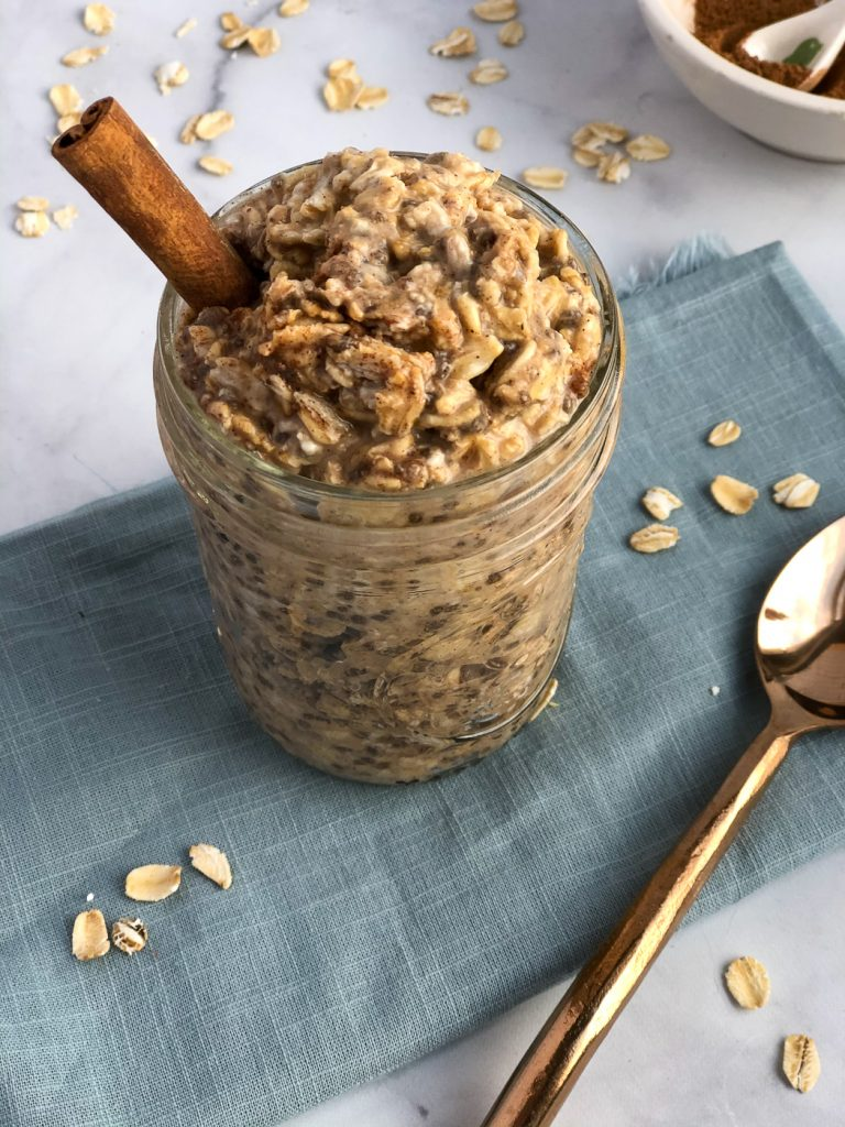 Jar of chai overnight oats with cbd and cinnamon stick