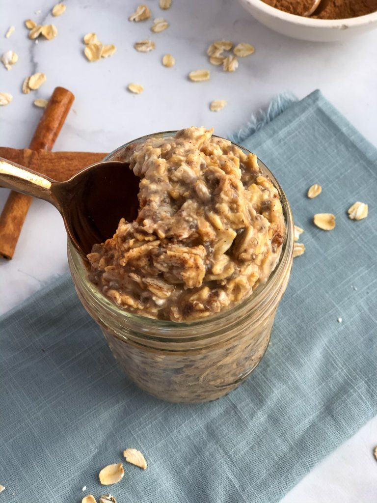 Taking spoonful of chai overnight oats