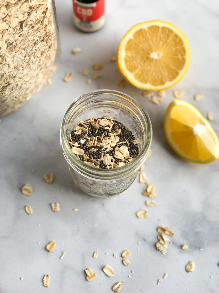 oats and chia seeds in mason jar with lemon on the side