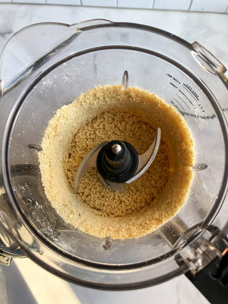 Pulsing cashews in a food processor