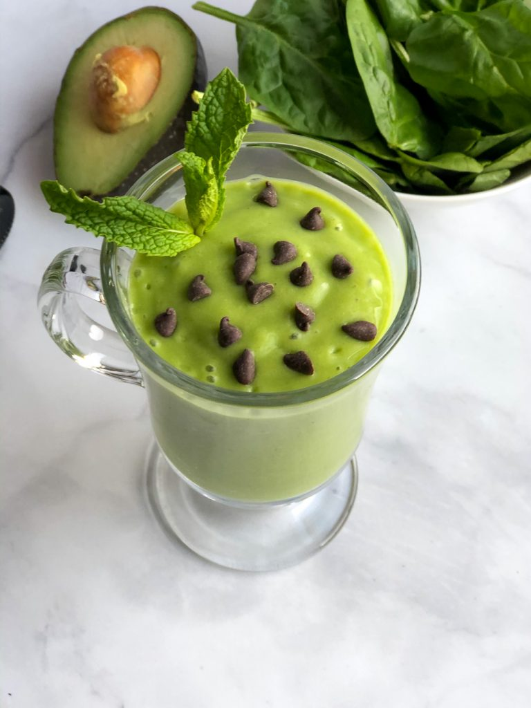 Glass of healthy vanilla mint smoothie with chocolate chips
