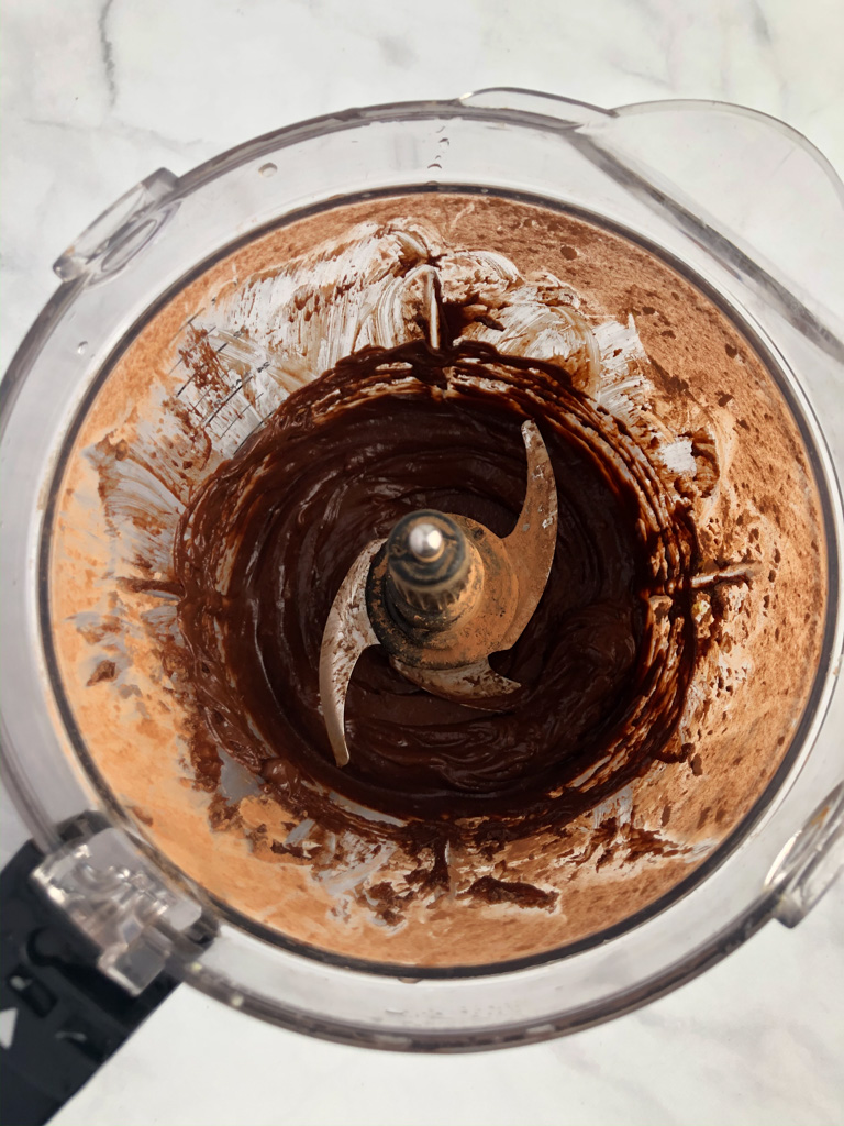 Making healthy avocado fudge frosting in the food processor