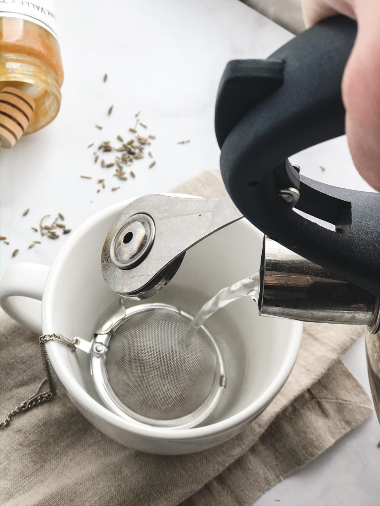 Pouring hot water onto dried lavender